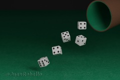 Dice rolling on a green cloth. 3d illustration.